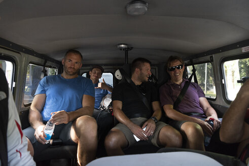 Tourists traveling in a van - ALRF01305