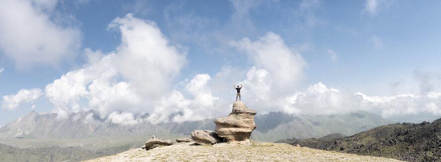 Russia, Caucasus, Mountaineer standing on rock formation in Upper Baksan Valley - ALRF01320