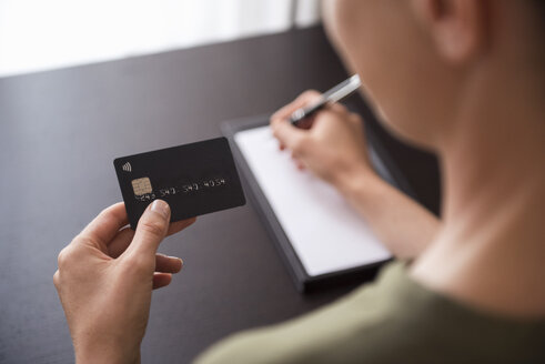Close-up of hand holding credit card - DIGF05116