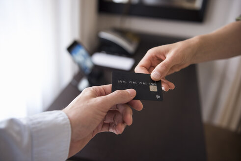 Handing over credit card - DIGF05119