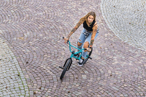 Young woman riding her BMX bike - STSF01761