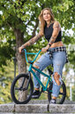 Young woman riding her BMX bike - STSF01764