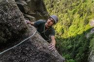Man trad climbing at The Chief, Squamish, Canada - CUF46085