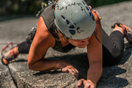 Woman trad climbing at The Chief, Squamish, Canada - CUF46088
