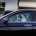 Dog sitting in driving seat of car, side view - CUF46106