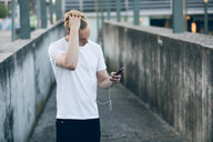 Young man using mobile phone - CUF46124
