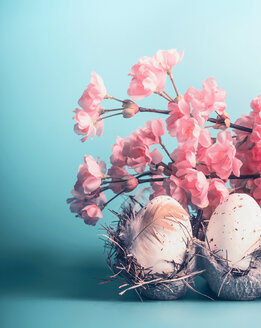Close-up of fresh pink flowers and eggs - INGF00472