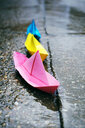 Color paper boats in a rainy day - INGF00541