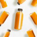 Yellow smoothie bottles on a white background - INGF00568