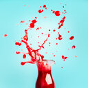 Studio shot of red juice with action splashes - INGF00607
