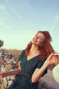 Young redhead woman enjoying life in holidays - INGF00712