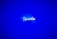 Close-up of an illuminated sign on a blue background - INGF00715