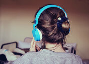 Back view of a young woman listening to music - INGF00721