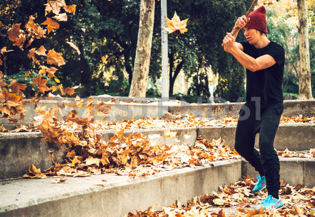 Man with stick playing with leaves - INGF00850 - Ingram Image/Westend61