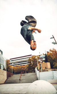 Man in motion, jumping above ground - INGF00859