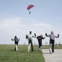 People standing in a field ready for parachuting - INGF01204