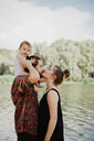 Couple with baby girl by lake, Arezzo, Tuscany, Italy - CUF46193