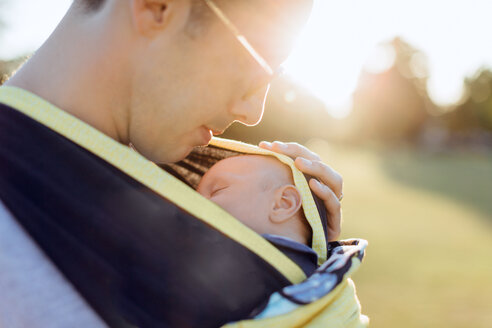 Father carrying baby boy in baby carrier - CUF46223