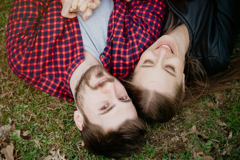 Couple lying down on grass - CUF46241