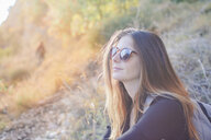Young woman on a hiking trip wearing sunglasses - AFVF01786