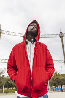 Portrait of a young black man wearing red hoodie - AFVF01808