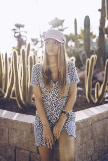 Attractive young woman wearing leopard print dress at cactus garden - RSGF00015