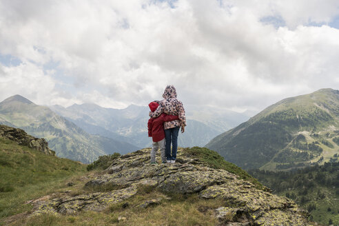 Andorra, Ordino, young girl and her brother, arm around, standing on viewpoint in the mountain - XCF00170