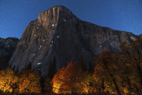Tranquil view of mountains against star field during night at Yosemite National Park - CAVF49263