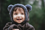 Close-up of cute baby girl in warm clothing standing at Yosemite National Park - CAVF49269