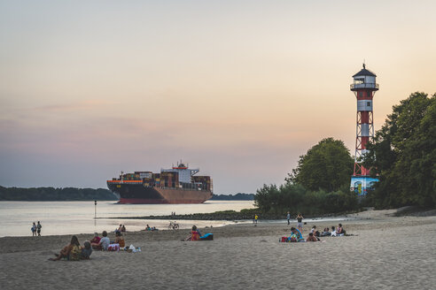 Germany, Hamburg, Hamburg-Rissen, beach and Lighthouse Wittenbergen, Container ship on Elbe river - KEB00954