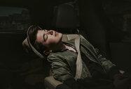Boy with eyes closed sitting in car - CAVF49536