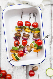 Vegetarian grill spits, orange and yellow paprika, tomato, red onion, zucchini and champignons - LVF07468