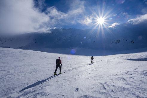 Two men doing a ski tour in Faragas mountains, Southern Carpathians, Romania - HAMF00499