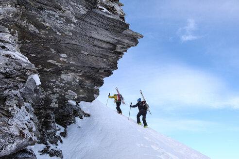 Two men doing a ski tour in Faragas mountains, Southern Carpathians, Romania - HAMF00505