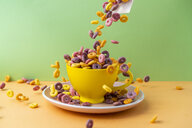 Cup and plate full of colourful cereals - AFVF01843