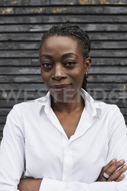 Portrait of smiling businesswoman wearing white shirt - IGGF00662