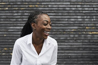 Portrait of laughing businesswoman  wearing white shirt - IGGF00665