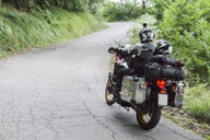 Father and son on a motorbike trip on a country road - FBAF00132