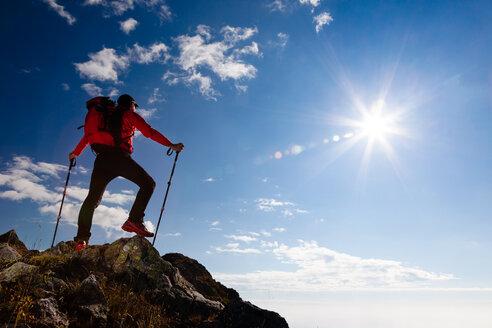 Mountain hiker on cliff - INGF02168