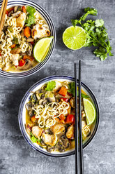 Ramen soup with egg, noodles, chicken meat, paprika, mushroom, spring onion, lime and coriander - SARF03947