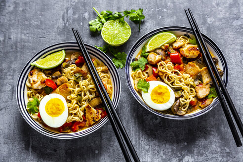 Ramen soup with egg, noodles, chicken meat, paprika, mushroom, spring onion, lime and coriander - SARF03950