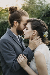 Affectionate bride and groom outdoors - ALBF00677