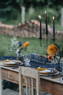 Festive laid table with candles outdoors - ALBF00695