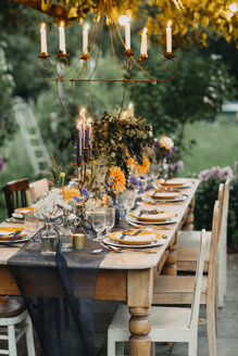 Festive laid table with candles outdoors - ALBF00701