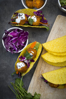 Sweet potato falafel in taco shells, with red cabbage, salad, carrot, yogurt sauce and black sesame - LVF07478