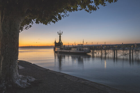 Germany, Baden-Wuerttemberg, Constance, Port entrance, Statue Imperia at sunrise - KEBF00978