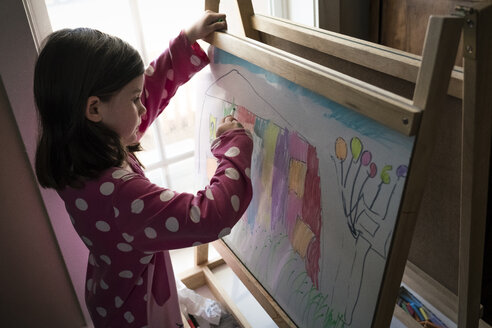 High angle view of cute girl drawing on artist's canvas at home - CAVF49794