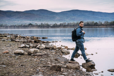 Russia, Amur Oblast, man with backpack at Zeya River - VPIF00916
