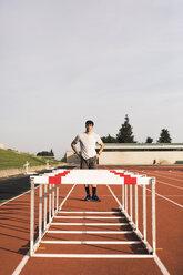 Young runner preparing for hurdle race - ACPF00348