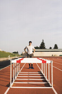 Young runner preparing for hurdle race - ACPF00348